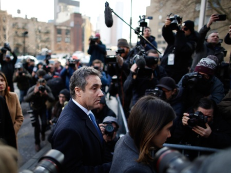 Michael Cohen, (L) President Donald Trump's former personal attorney and fixer, arrives at federal court for his sentencing hearing, December 12, 2018 in New York City