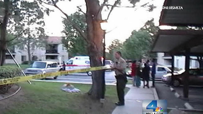 Sheriff's deputies cordon off the area around a Palmdale apartment complex where a boy was nearly drowned in the swimming pool on Thursday, May 24, 2012.