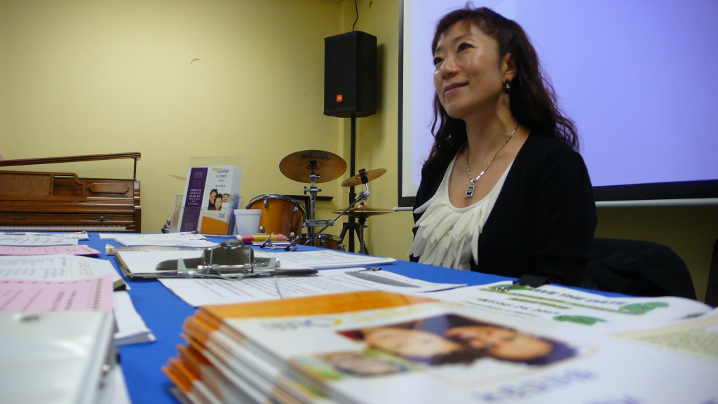 Young Ahn, mental health services coordinator for the Los Angeles County Department of Mental Health, answers questions at a health fair at the Los Feliz United Methodist Church.