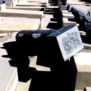Toppled headstones at East LA's neglected Mt Zion cemetery.