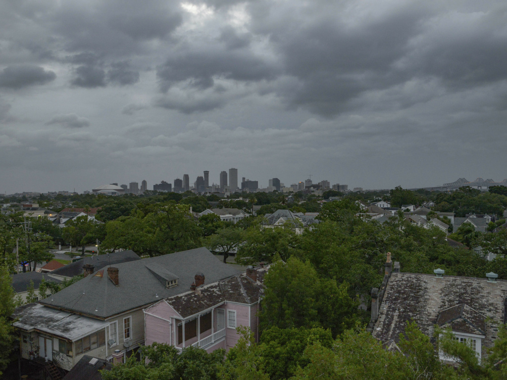 Clouds from Tropical Storm Barry spin over downtown New Orleans on Saturday. The storm has been fueled by climate change, which is also exacerbating potential flooding.