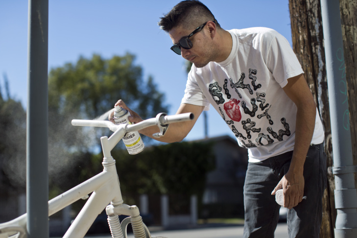 Danny Gamboa puts finishing touches on a ghost bike.