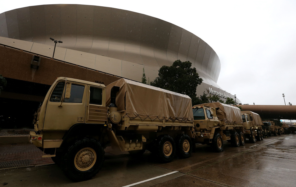 Members of the U.S. National Guard arrive at the Mercedes-Benz Superdome as New Orleans prepares for Hurricane Nate on Saturday, October 7, 2017.