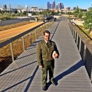 Sean Woods, Superintendent of California State Parks stands on a bridge in the L.A. State Historic Park. Once a river, the new park aims to recreate native waterways. The river would return during a rainy season.