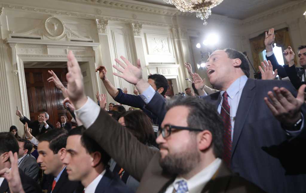 WASHINGTON, DC - FEBRUARY 16:  Reporters attempt to pose questions to U.S. President Donald Trump during a news conference in Washington, DC.  (Photo by Mario Tama/Getty Images)