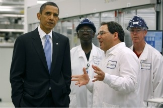 President Barack Obama tours the Solyndra solar panel company with Executive VP of Engineering Ben Bierman May 26, 2010 in Fremont, California.