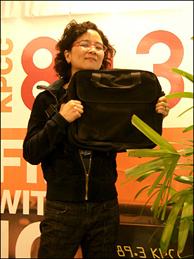 Off-Ramp producer Queena Kim strikes a pose with the coveted laptop bag.