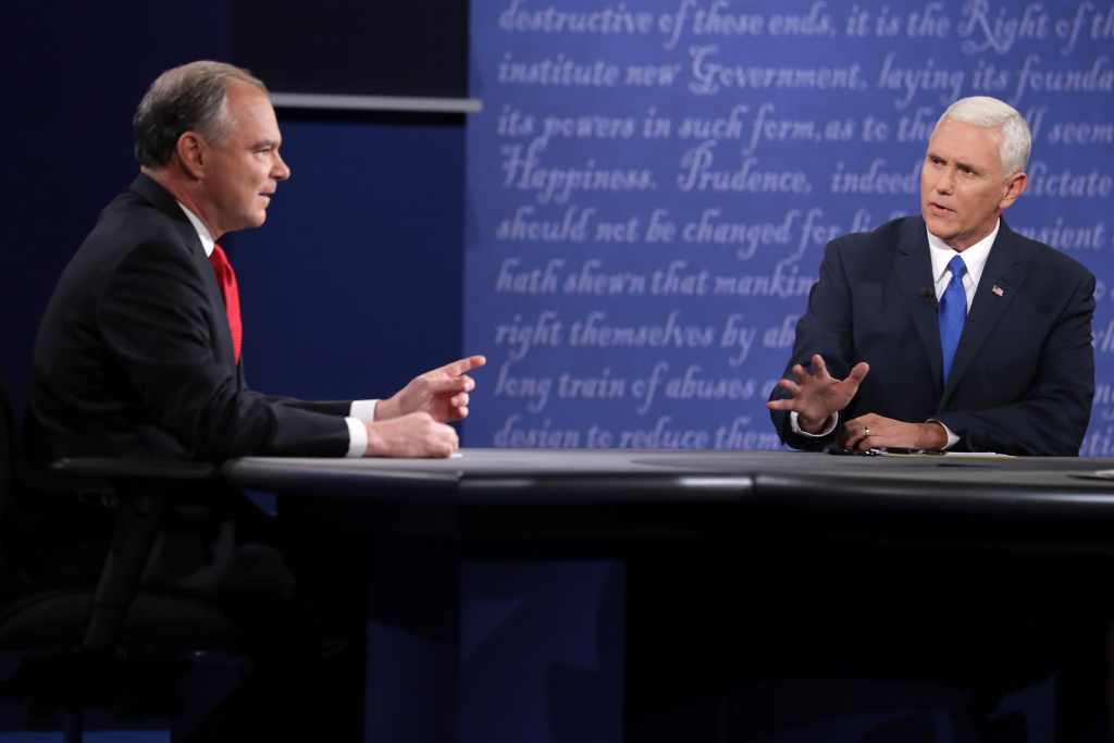 Democratic vice presidential nominee Tim Kaine (L) and Republican vice presidential nominee Mike Pence (R) speak during the Vice Presidential Debate at Longwood University.