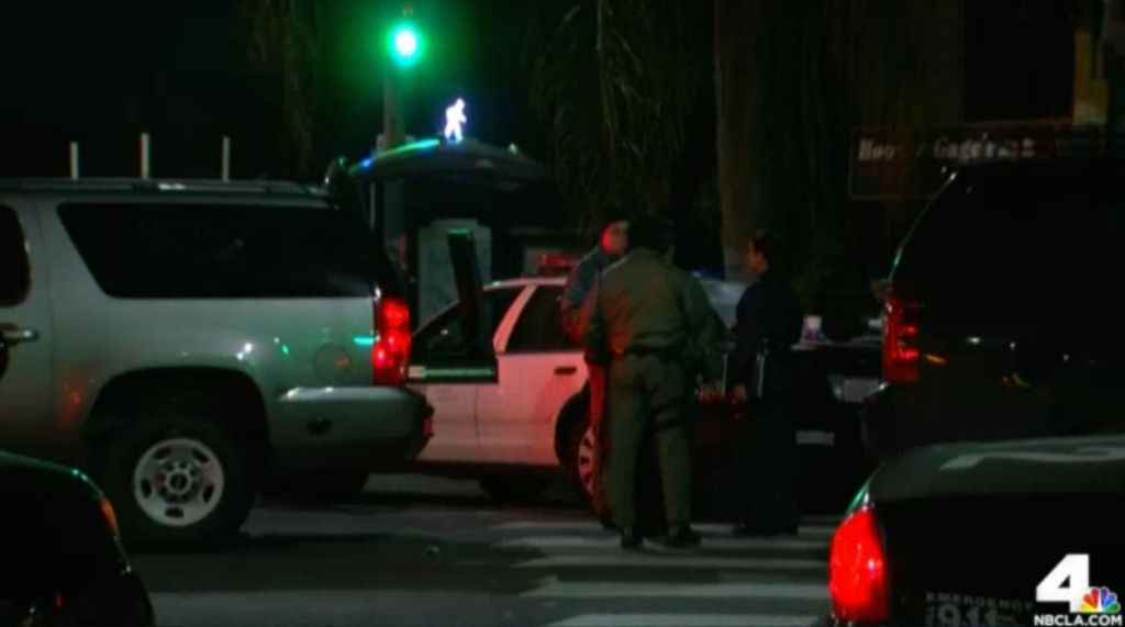 A man opened fire on a police car in South Los Angeles Sunday night, but no one was hurt. The suspect was eventually arrested, and police searched for a second suspect without success.