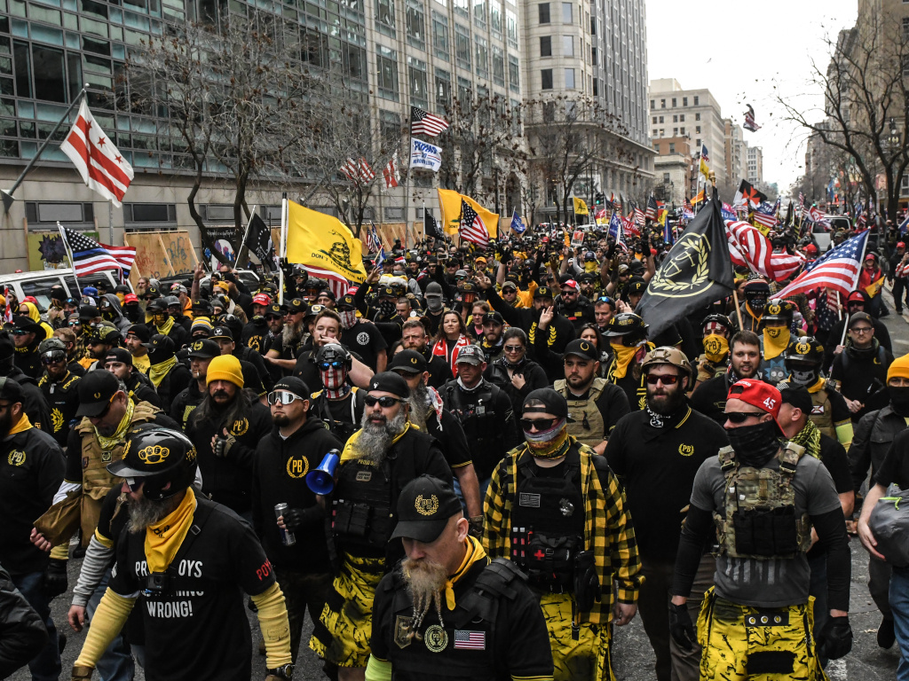 Members of the Proud Boys march toward Freedom Plaza during a protest in December 2020 in Washington, D.C. The Proud Boys has been designated as a hate group by the Southern Poverty Law Center.