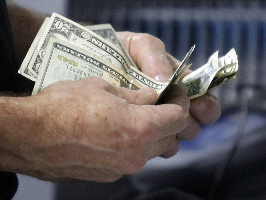The U.S. economy grew at an annual rate of 1.8 percent in the first three months of the year, significantly slower than first thought. The Commerce Department said the steep revision was mostly because consumers spent less.