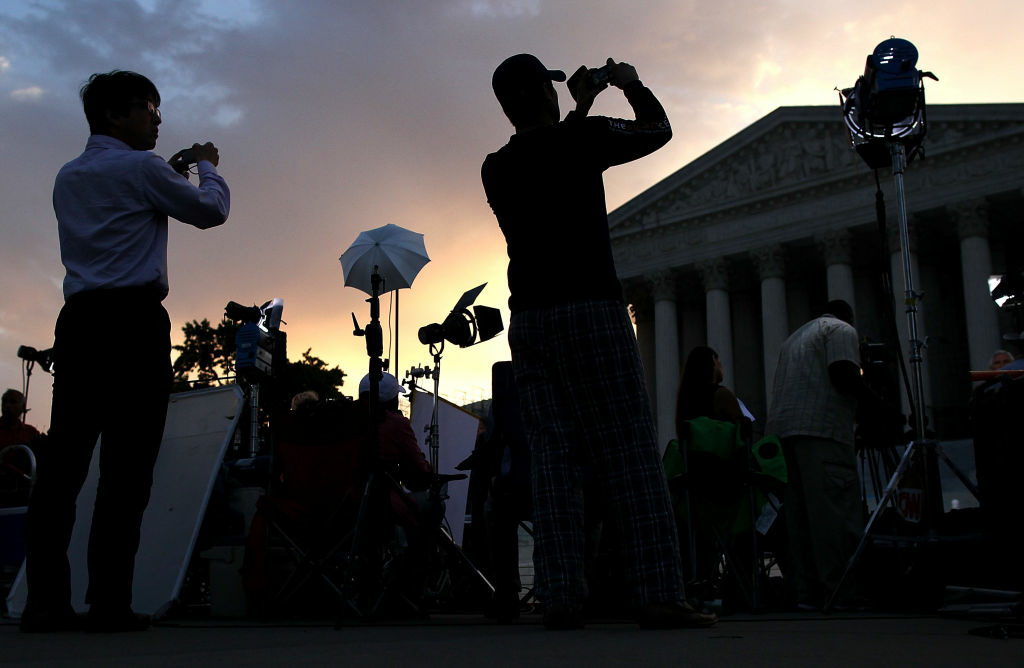 People start to gather in front of the U.S. Supreme Court on June 28, 2012 in Washington, D.C.