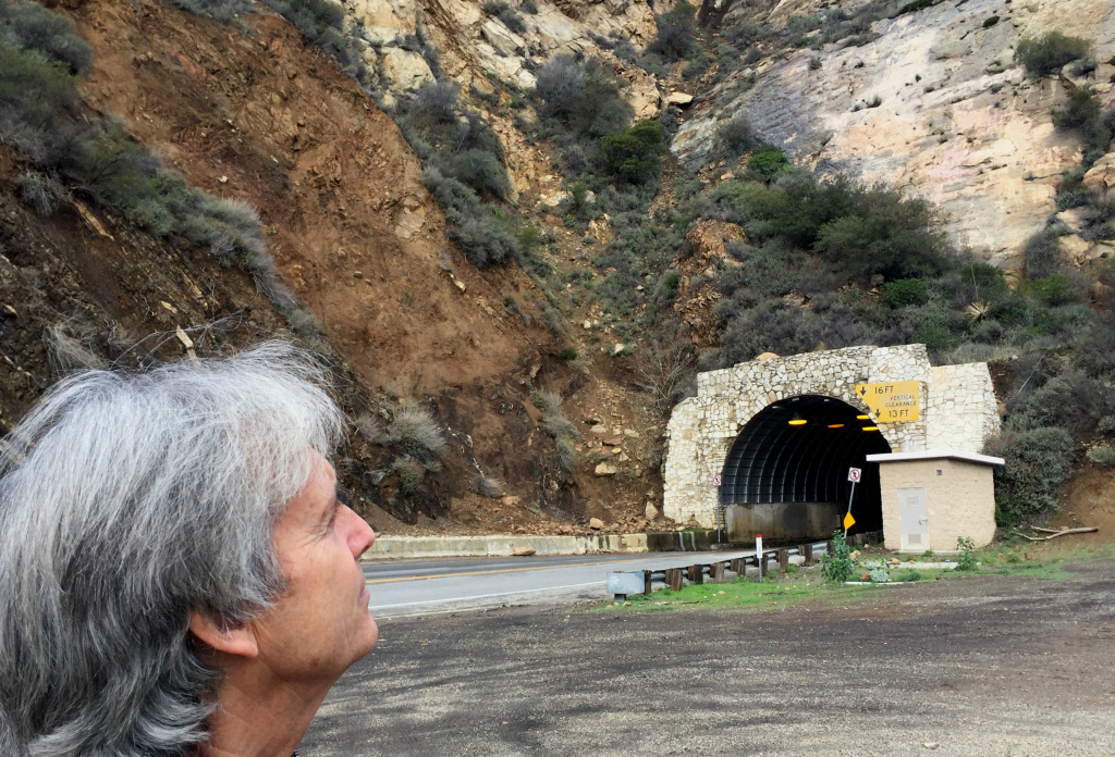 Stephen Seemayer looking at the cliff face above the Malibu Canyon tunnel where his mom, Lynne Westmore Bloom, painted the 60-foot Pink Lady in 1966.