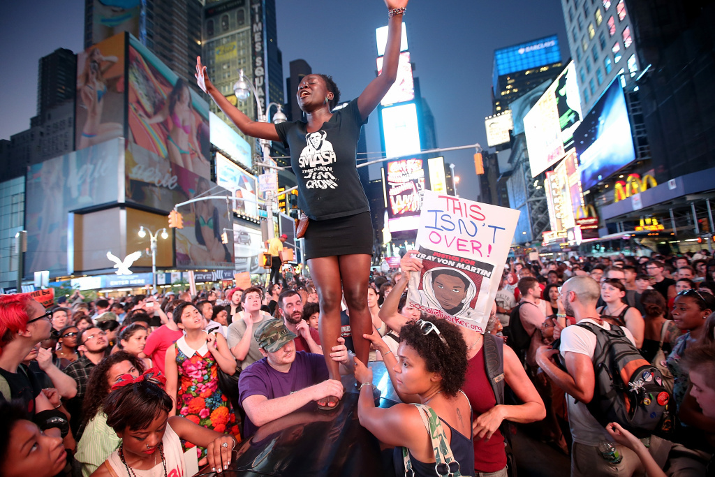 Trayvon Martin supporters rally in Times Square while blocking traffic after marching from a rally for Martin in Union Square in Manhattan on Sunday in New York City.