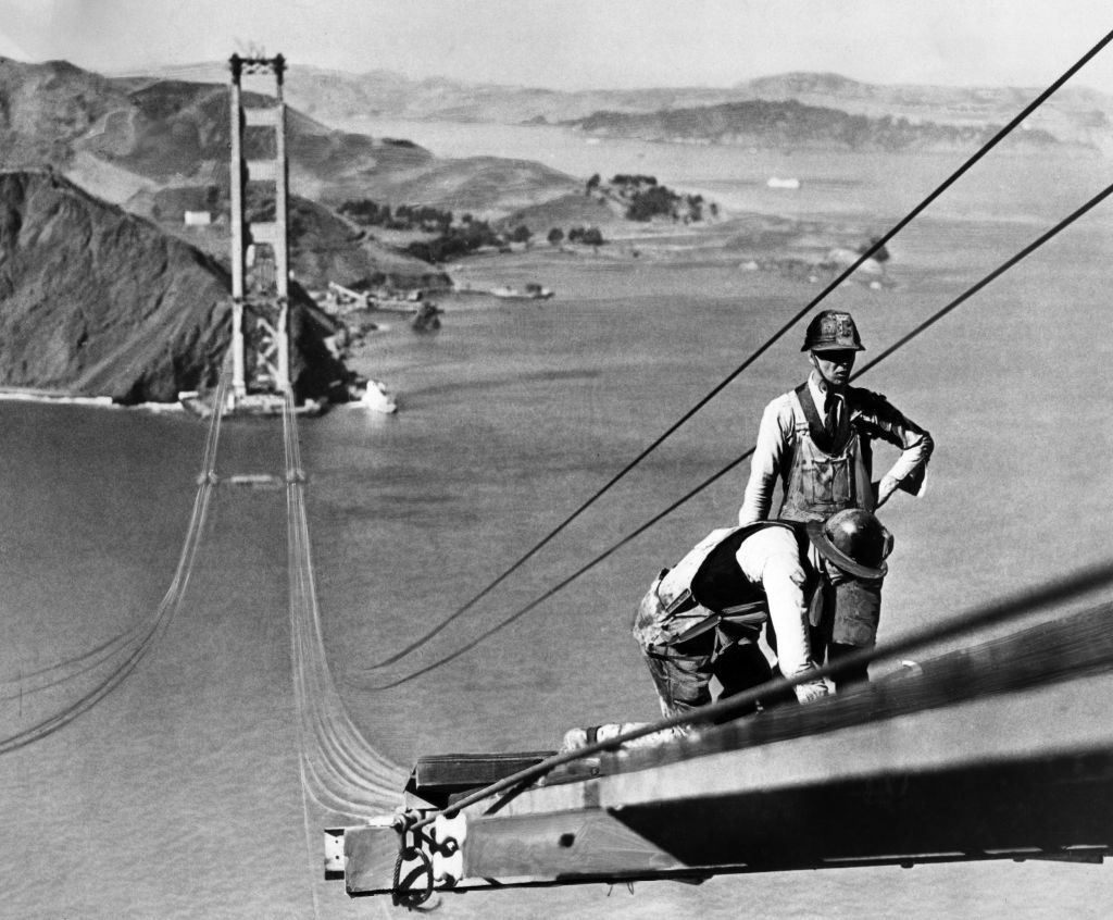 Construction of the Golden Gate Bridge in October, 1935, in the San Francisco Bay. Construction began on January 5,1933 and was inaugurated May 27, 1937 by Franklin Delano Roosevelt — who pushed a button in Washington, DC, to signal the official start of vehicle traffic over the Bridge.