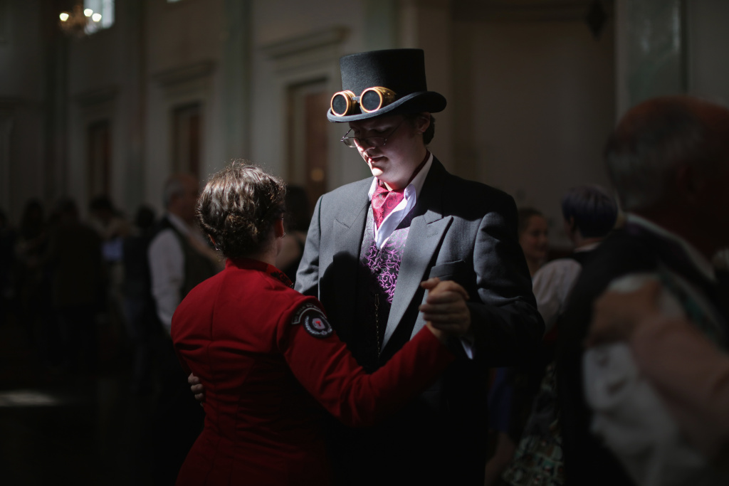 Costumed enthusiasts attend a dancing class during the Asylum Steampunk festival in Lincoln, England on August 29, 2015.