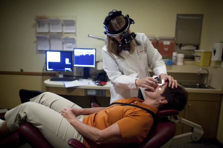 Ophthalmologist Dr. Lisa Olmos de Koo examines Lisa Kulik's prosthetic retina at the USC Eye Institute. Kulik is one of the first patients to use the Argus II prosthetic retina, which was developed to help people with retinitis pigmentosa, a degenerative eye disease that causes vision impairment and often blindness.