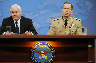 U.S. Secretary of Defense Robert M. Gates (L) and Chairman, Joint Chiefs of Staff Adm. Mike Mullen conduct a press briefing on the replacement of U.S. Gen. Stanley McChrystal and the war in Afghanistan June 24, 2010 in Arlington, Virginia.