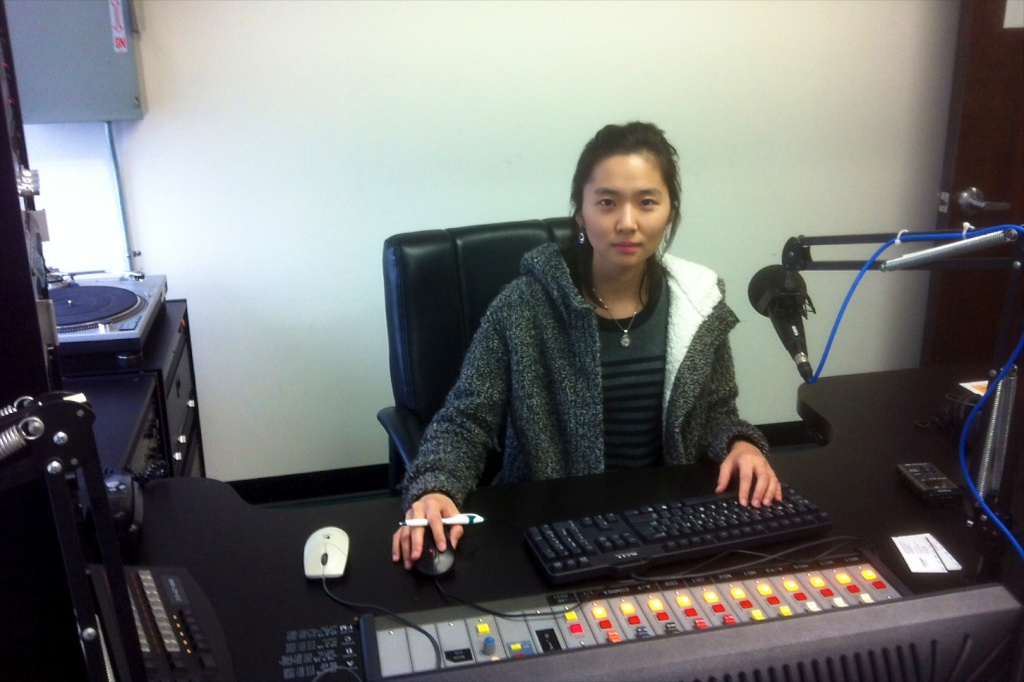 News Reporter Hyun Lindsey Park gathers interviews at Radio Korea about the death of North Korea's leader Kim Jong II.