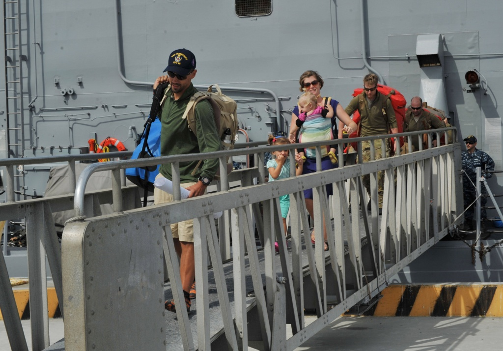 In this handout provided by the U.S. Navy, the Kaufman family disembarks the Oliver Hazard Perry-class guided-missile frigate USS Vandegrift (FFG 48) at Naval Air Station North Island April 9, 2014 in San Diego, California.