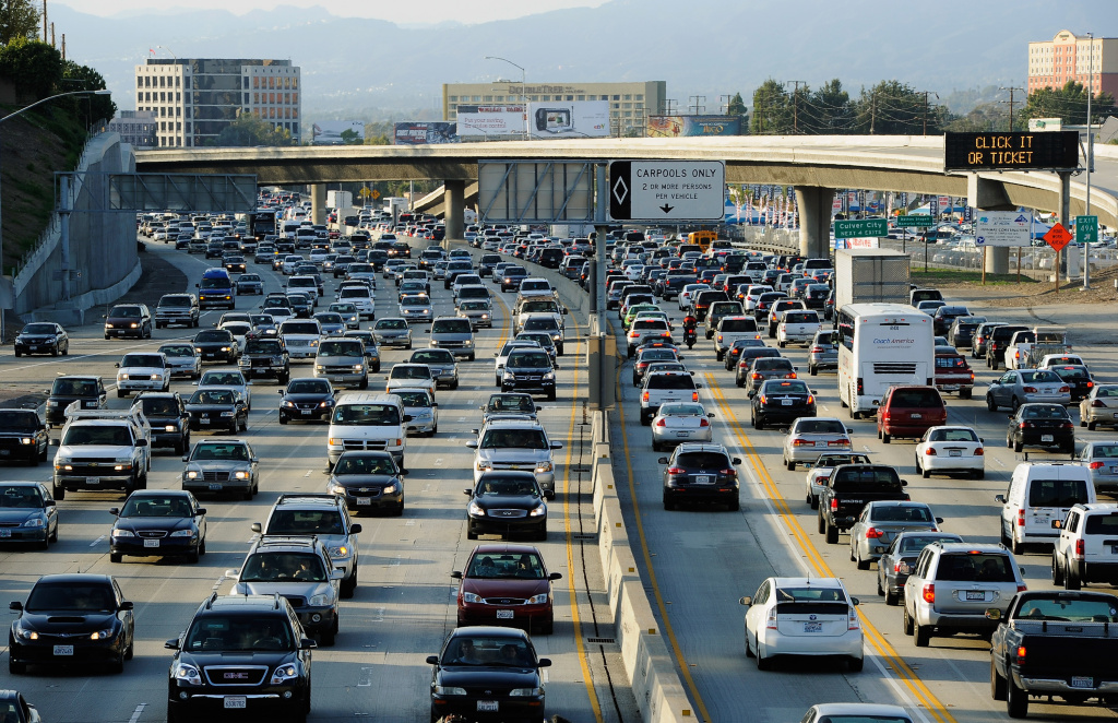 In this file photo, traffic comes to a standstill on the northbound and the southbound lanes of the Interstate 405 freeway near Los Angeles International Airport. A visit by Israeli Prime Minister Benjamin Netanyahu was expected to cause temporary closures and traffic tie-ups from Tuesday to Thursday, March 4 to 6, 2014.