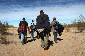 File photo: Undocumented Mexican immigrants walk through the Sonoran Desert after illegally crossing the U.S.-Mexico border border on January 19, 2011 into the Tohono O'odham Nation, Arizona.