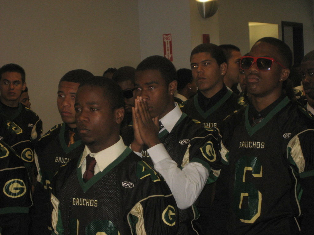 Members of the Narbonne High School Football team dressed in their jerseys for the funeral of team-mate Dannie Farber.
