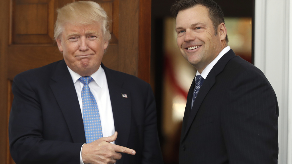 Former Kansas Secretary of State Kris Kobach is greeted by President Trump in 2016 at the Trump National Golf Club Bedminster clubhouse in Bedminster, N.J.