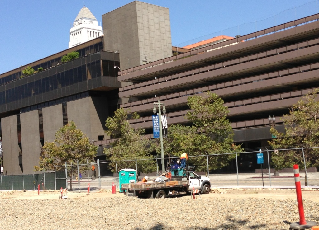 Workers at the site of the new Civic Center Park near 2nd and Broadway in downtown Los Angeles.