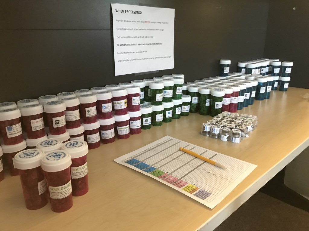 Vials of medical marijuana line a desk at the headquarters of a delivery service in south Orange County on Nov. 29, 2017. Come Jan. 1, 2018, Californians will be legally allowed to buy recreational cannabis. But most cities and counties have placed bans on cannabis businesses.