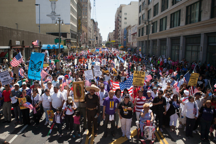 Protesters take up the front line of the May Day parade as it reaches 5th Street in Downtown Los Angeles on May 1, 2013.
