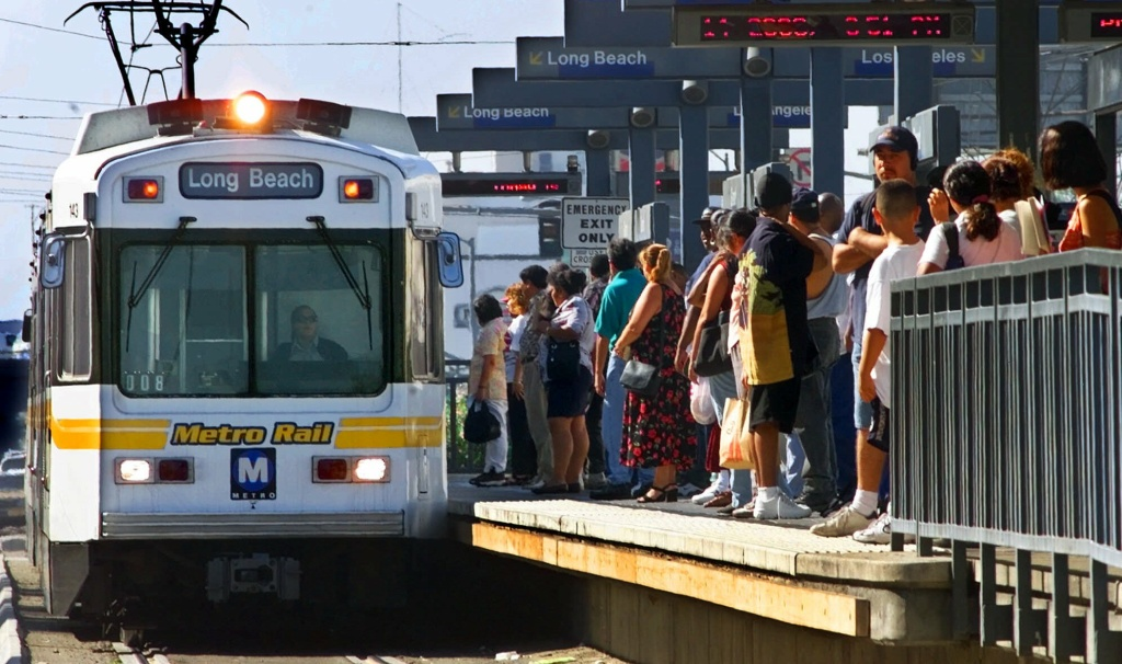 File: Passengers prepare to board a Long Beach-bound Metro Rail Blue Line train at Washington and Grand near downtown Los Angeles on Thursday, Sept. 14, 2000.