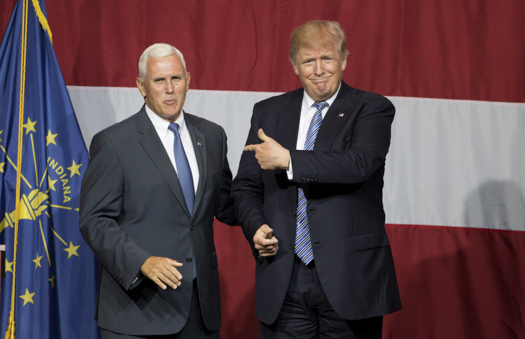 Presumptive US Republican presidential candidate Donald Trump (R) and Indiana Governor Mike Pence (L) take the stage during a campaign rally at Grant Park Event Center in Westfield, Indiana, on July 12, 2016. Trump named Pence as his vice presidential running mate in a tweet early Friday.