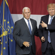 Presumptive US Republican presidential candidate Donald Trump (R) and his now-vice presidential nominee Indiana Governor Mike Pence (L) take the stage during a campaign rally at Grant Park Event Center in Westfield, Indiana, on July 12, 2016.