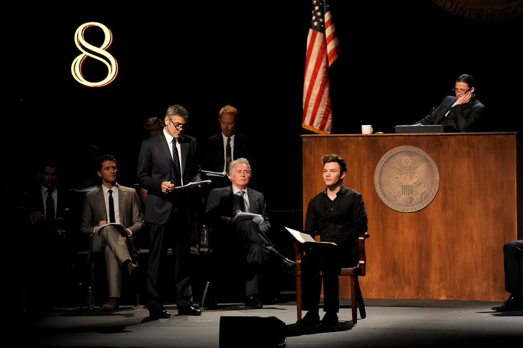 (L-R) Actors  Matt Bomer, Matthew Morrison, George Clooney, Jesse Tyler Ferguson, Martin Sheen, Chris Colfer, and Brad Pitt onstage during the one-night reading of