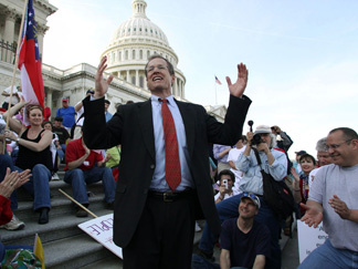 Republican Rep. Jack Kingston of Georgia, speaks to people demonstrating against the health care bill on the U.S. Capitol steps Saturday.