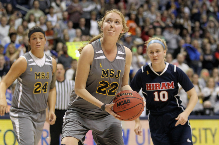 File: Lauren Hill of Mount St. Joseph shoots to score her second basket during the game against Hiram at Cintas Center on Nov. 2, 2014 in Cincinnati, Ohio. Hill, a freshman, had terminal cancer and this game was granted a special waiver by the NCAA to start the season early so she could play in a game.