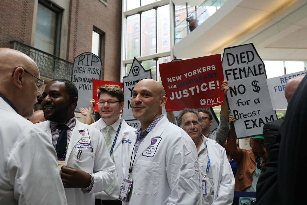 Doctors, nurses, patients and activists listen as Senate Minority Leader Chuck Schumer (D-NY) speaks at Bellevue Hospital a day after the Republicans released their health care bill to the public on June 23, 2017 in New York City.