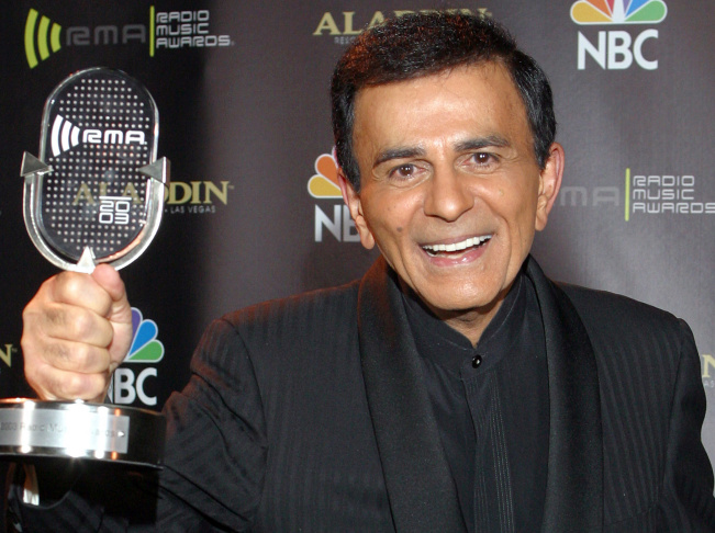 In this Oct. 27, 2003 file photo, Casey Kasem poses for photographers after receiving the Radio Icon award during The 2003 Radio Music Awards in Las Vegas. A judge on Tuesday, Oct. 15, 2013, delayed a decision on whether to create a temporary conservatorship for Kasem after a court-appointed attorney told him the ailing radio personality is receiving adequate daily care.