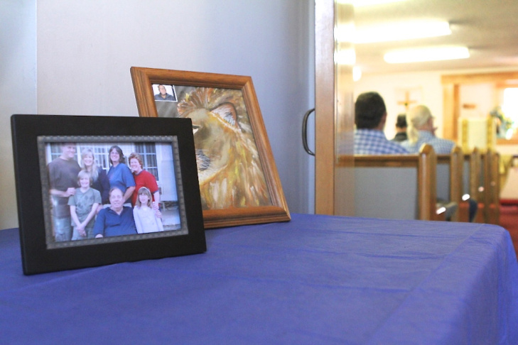 A picture of the McKaig family is displayed outside a memorial for Byron and Gladys McKaig on July 23, 2016, in Kernville, California. The couple was killed in the Erskine fire.