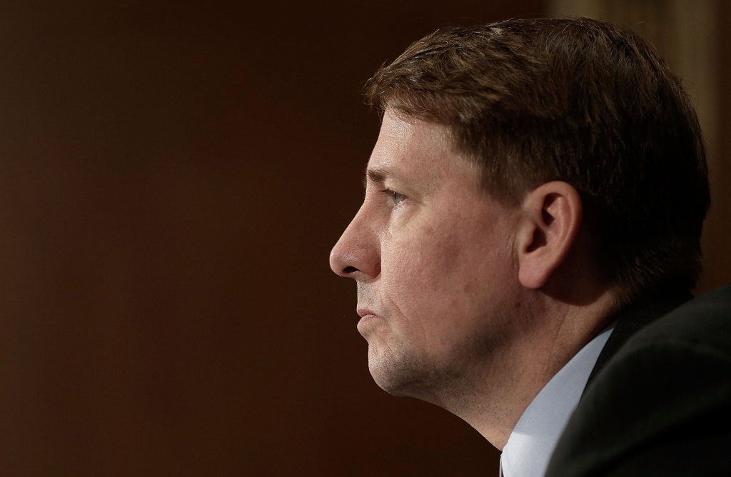 In this file photo, Consumer Financial Protection Bureau Director Richard Cordray testifies before the Senate Banking, Housing and Urban Affairs Committee November 12, 2013 in Washington, DC. The CFPB says it has filed suit against ITT Educational Services, alleging the for-profit college chain pushed students into high-cost private student loans.