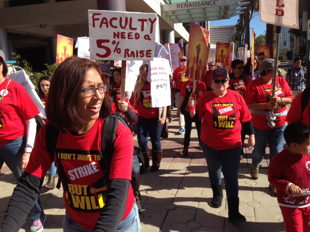 File: Cal State faculty supporters march in Long Beach in November 2015 to support a 5 percent salary increase.