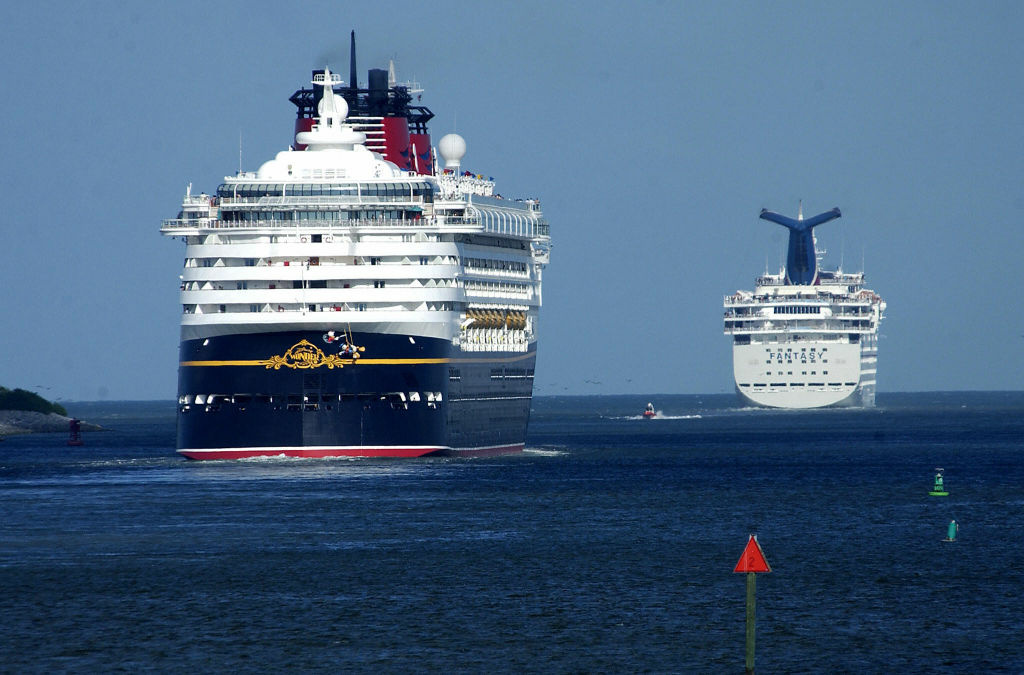 Cruise ships Disney's Wonder (L) and Carnival's Fantasy (R) head for sea Florida's Port Canaveral.