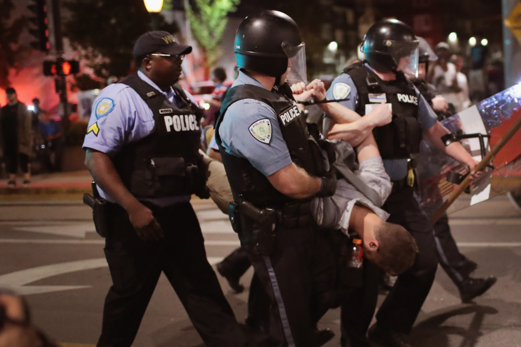 Police arrest a demonstrator protesting the acquittal of former St. Louis police officer Jason Stockley on September 16, 2017 in St. Louis, Missouri.
