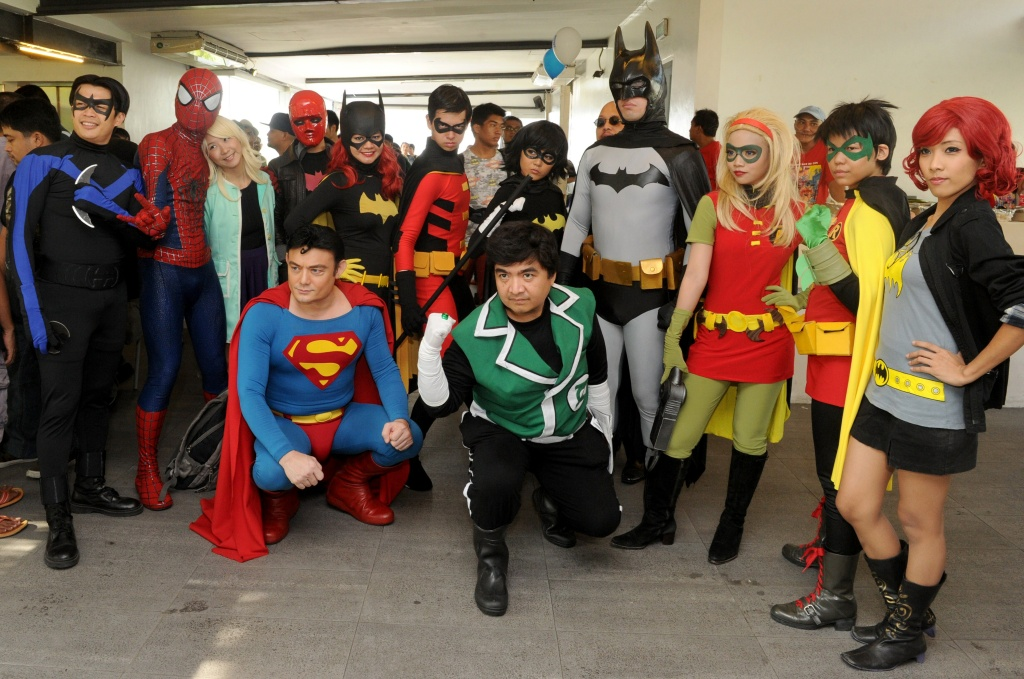 Comic enthusiasts dressed as comic book characters including Batman, Spiderman and Superman pose for photos as they attend a Free Comic Book Day event in Manila, Philippines on May 3, 2014.