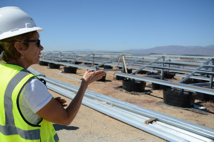 Workers install solar panel frames at the Milliken Landfill in Ontario.