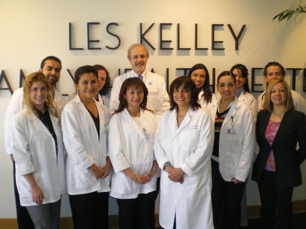 Dr. Blanca Campos (3rd from L, 1st row) standing with Executive Director Dr. Michelle Bholat (3rd from R, 1st row), former program coordinator Ana Jimenez (1st row R), Associate Director Patrick T. Dowling (3rd from L, 2nd row) and Blanca's graduating class of UCLA IMG colleagues in their program's headquarters.