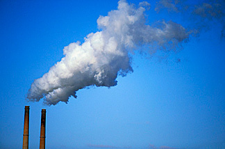 Greenhouse gases being emitted into the atmosphere.
