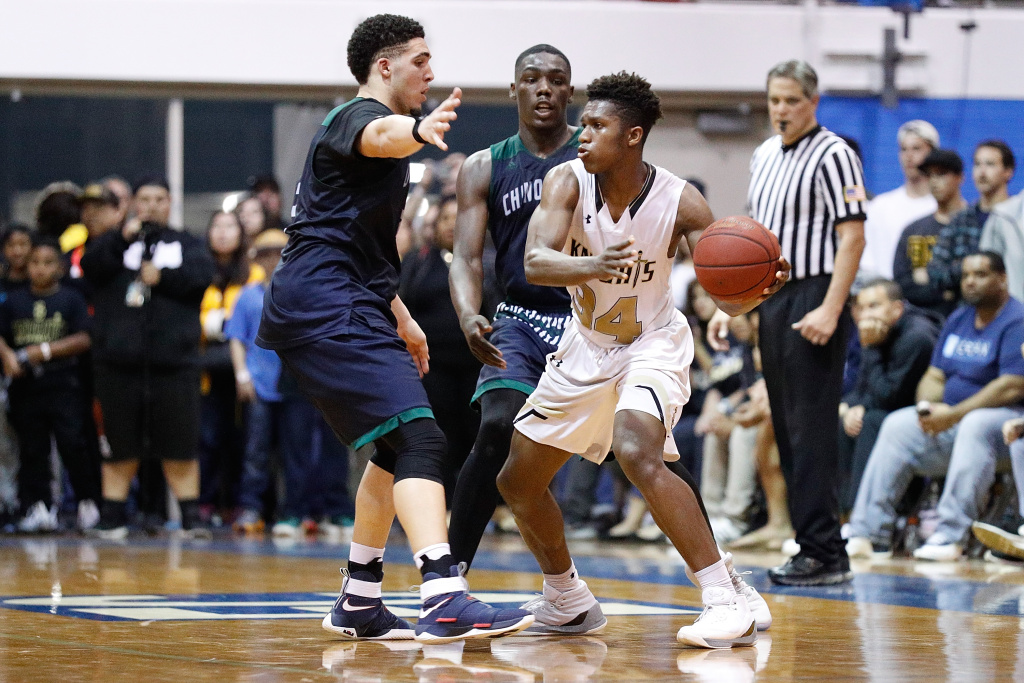 David Singleton #34 of Bishop Montgomery High School passes the ball while being guarded by LiAngelo Ball #3 of Chino Hills High School during the game between Chino Hills High School and Bishop Montgomery High School at El Camino College on March 14, 2017 in Torrance, California.
