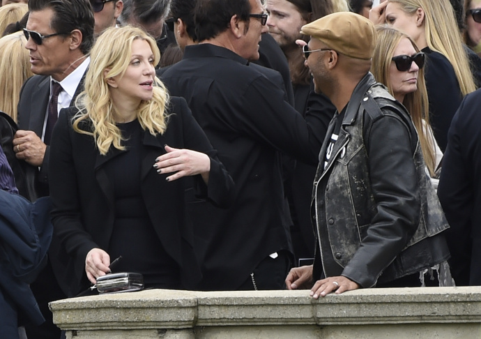 Matt Cameron, of Soundgarden, right, hugs a guest at a funeral for Chris Cornell, pictured right, at the Hollywood Forever Cemetery on Friday, May 26, 2017, in Los Angeles.